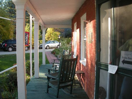 Birchwood Inn: Front porch-sun setting