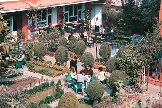 Hotel Encounter Nepal: hotel building with garden