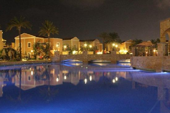 Aliathon Holiday Village: Swimming pool lit up at night