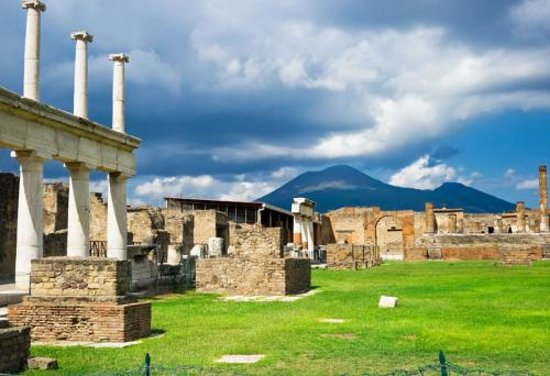 Walks of Italy: View into the Pompeii Ruins, with Mount Vesuvius looming in the distance