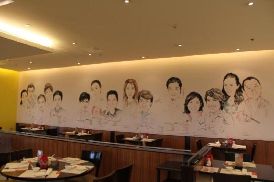 This restaurant has a mural painting of chinese for Mural restaurant