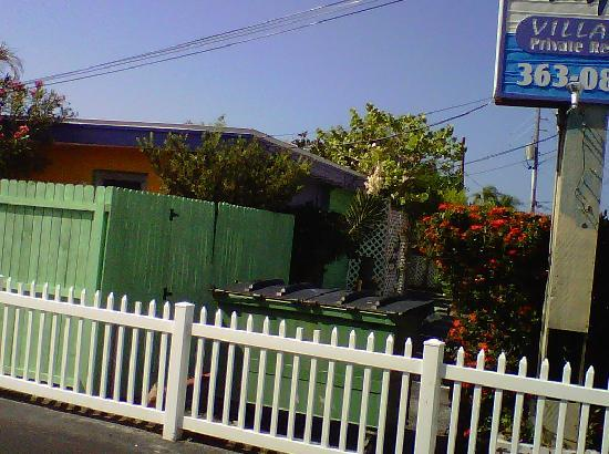 Whispers Resort: View of dumpster from street