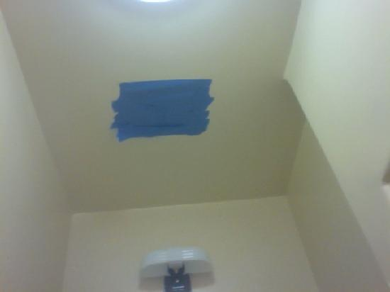 Bancroft Hotel: blue tape patch on bathroom ceiling