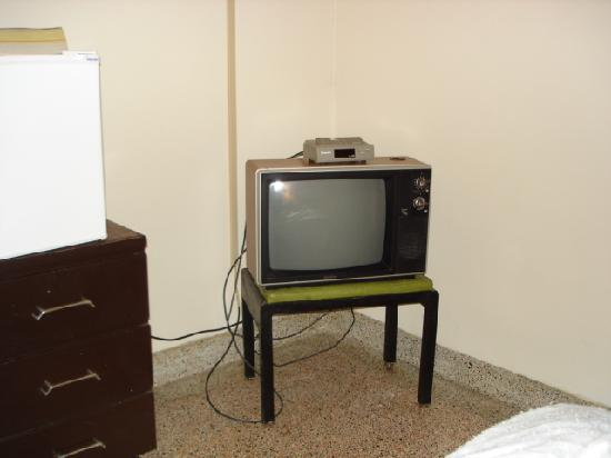 "Evergreen Motel : the TV with a 2"" melted area on top, withou voume control"