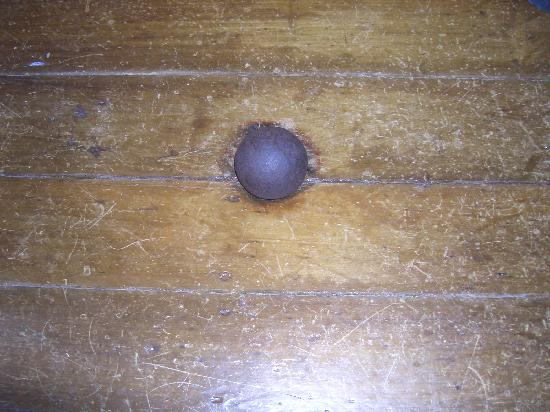 Franklin, TN: Cannonball sitting in floor dent