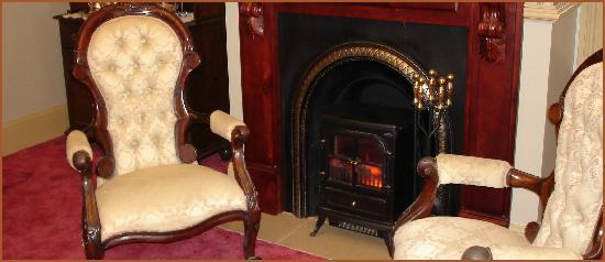 Bli Bli House Luxury Accommodation: Elegant Victorian fireplaces in each suite