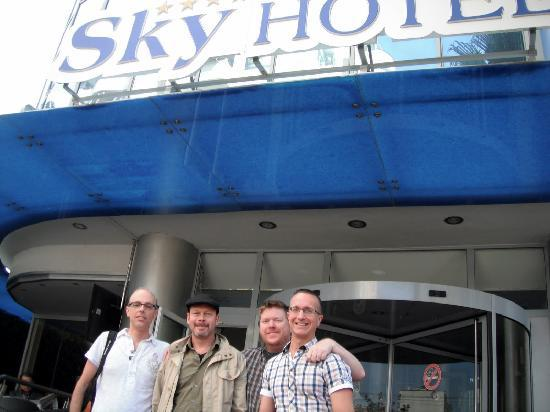 Four of us in front of Sky Hotel Tirana