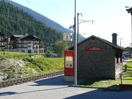 Hotel Hubertus: Obergesteln station with hotel behind.