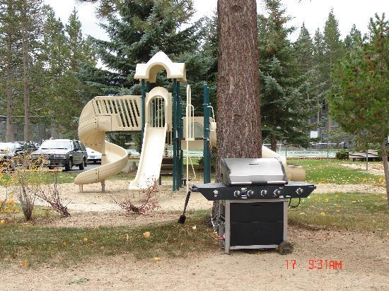 Tahoe Beach and Ski Club: BBQ grills and kids playground at the resort