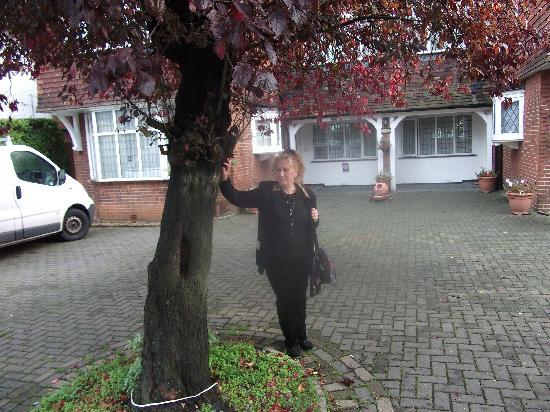 My wife in front of Martel Guest House.
