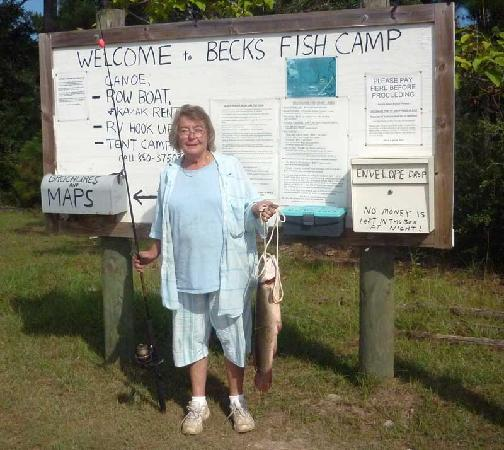 """Becks Lake Fish Camp: Lessie, the manager's wife with  a """"Bowfin"""""""