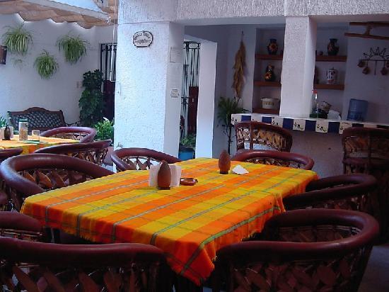Hostal de María: kitchen area off dining area