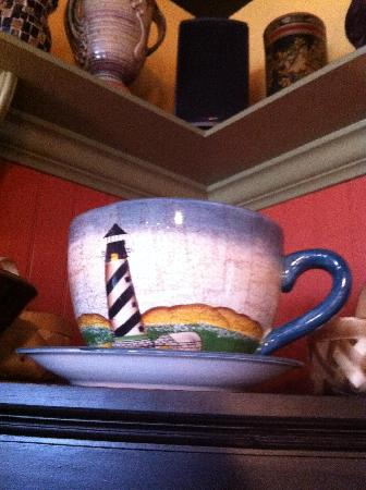 """Dancing Turtle: Cape Hatteras Lighthouse """"big"""" cup and saucer on a shelf"""