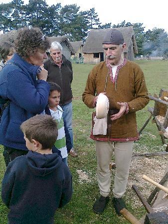 West Stow Country Park and Anglo-Saxon Village: A villager showing us how he carved bowls.