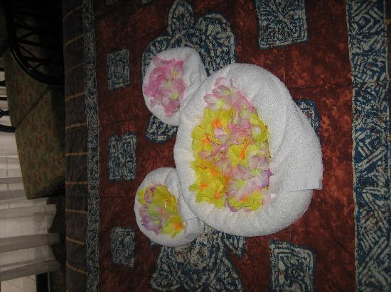 Disney's Polynesian Village Resort: On our bed when we arrived -- the flowers are leis