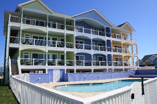 Waves Village Resort : Overlook the Pool, Waterfront, and get free Sunsets!