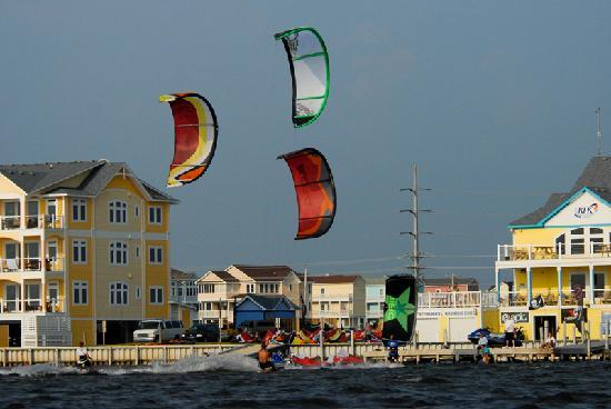 Waves Village Resort: Kiteboarders riding next to the Resort