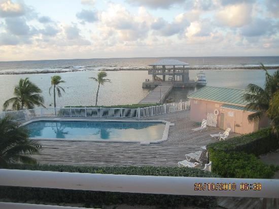 Carib Sands Beach Resort: Another view of the pool dock and breakwater from our porch