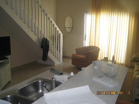 Carib Sands Beach Resort: A bit of a view of the living room, kitchen and porch door.