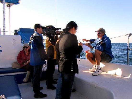 Dana Point, CA: Captain Tom being interviewed by a Korean news team who were filming some footage for a whale wa