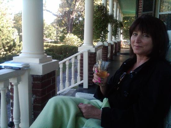 Evergreen:  The Bell-Capozzi House: Relaxing on the porch with a cup of tea.