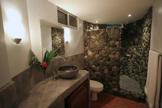 Villas Oasis: Exotic river rock shower and crisp white walls of the Secret Garden Villa bathroom