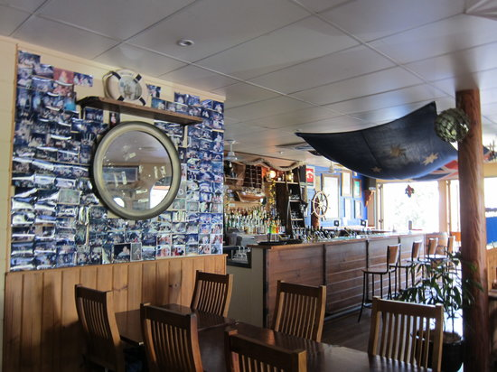 Shipwrecked Seafood and Bar: The bar and wall of photos.