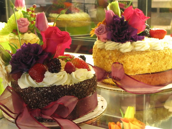 all cakes are very beautifully decorated with flowers Picture of