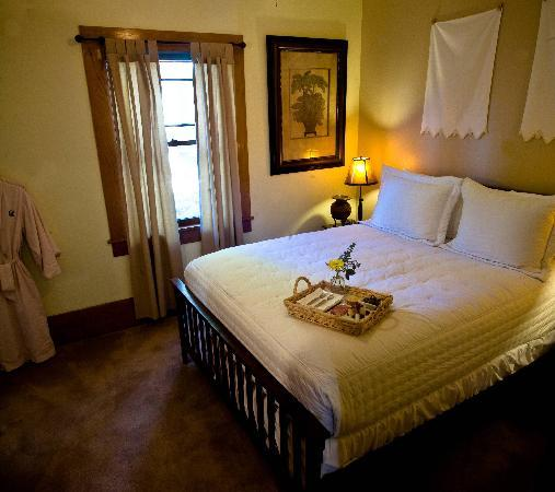 The Cooper House Bed & Breakfast Inn: The Cabernet Suite queen bed with private sitting room