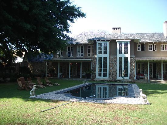 Grendon House: back of house with pool and vernada
