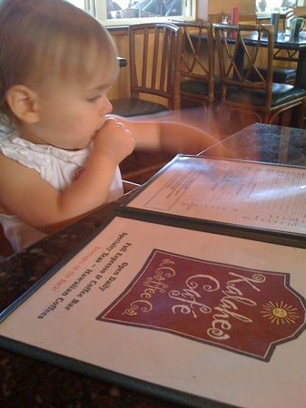Kalaheo Cafe & Coffee Company: My daughter surveying the menu at Kalaheo Cafe :)
