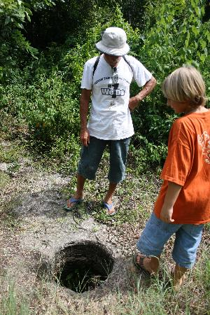 Chez Didi: Tour Guide showing one of the Maya's Well