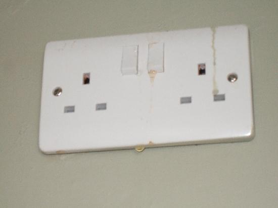 St. James Apartments: Kitchen socket wet after leak, old stains also present