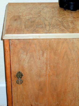 St. James Apartments: Old, stained bedside cabinet - NOT modern & stylish furnishings as stated!