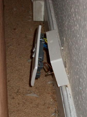 St. James Apartments : Plug socket hanging off wall & wires exposed