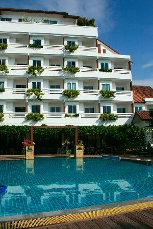 Sea Orchid: The pool by day, with the slightly larger deluxe rooms above.