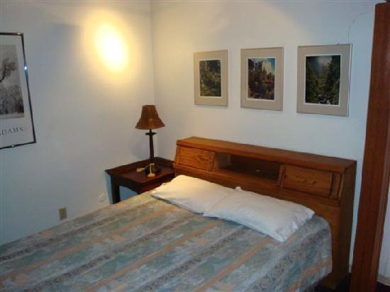 Yosemite West Condominiums: Queen bed in loft, room dividing curtain on right