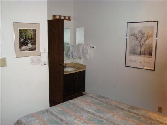 Yosemite West Condominiums: Vanity and closet area at foot of bed
