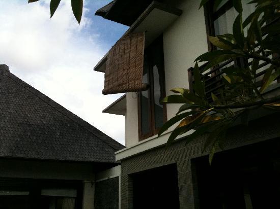The Sanyas Suite Seminyak: Broken blind hanging loosely outside villa