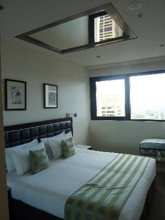 Bedroom with mirror in Ceiling - Picture of Meriton Suites ...