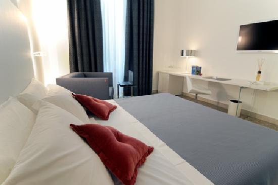 TownHouse Cavour : Luminosa e confortevole la camera Luce riflette un ambiente moderno e sofisticato