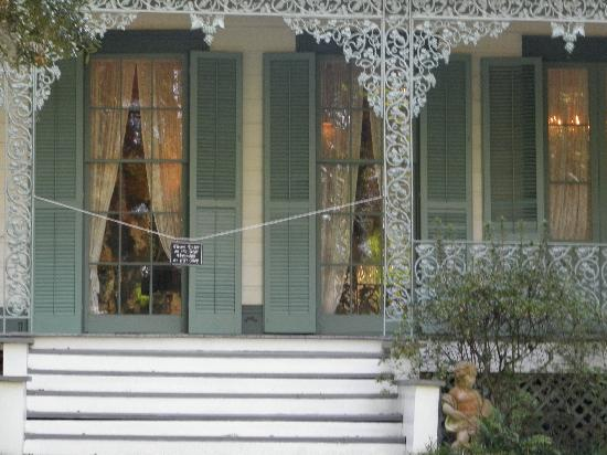 The Myrtles Plantation : Girl in yellow dress in window, about two panes high