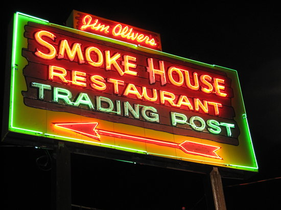 The Smoke House Lodge & Cabins: The symbol and trademark of the Smoke House all these years shows up brightly after dark