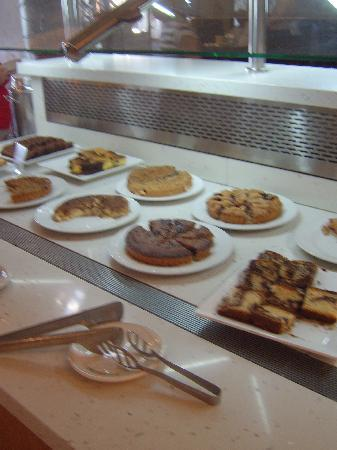 Atlantica Golden Beach Hotel: Cakes and sweets at the breakfast buffet (cereal in the background)