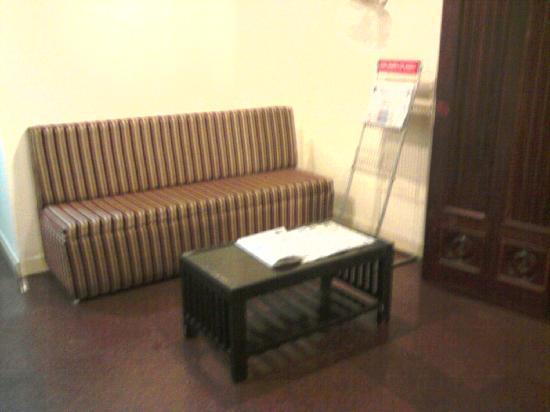 Orchid Inn: corridor sitting arrangment for reading news paper