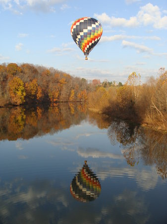 Blue Ridge Balloon: Gliding across the water with another balloon nearby