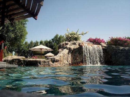 Great hotel away from the city with awesome pools the for Garden pool reviews