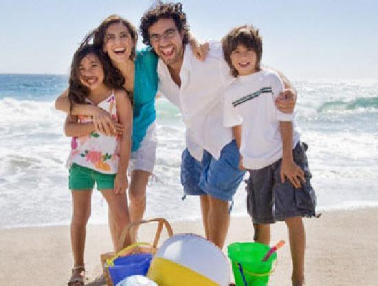 Mar de Canasvieiras Hotel & Eventos: eu e minha familia na praia de Florianópolis