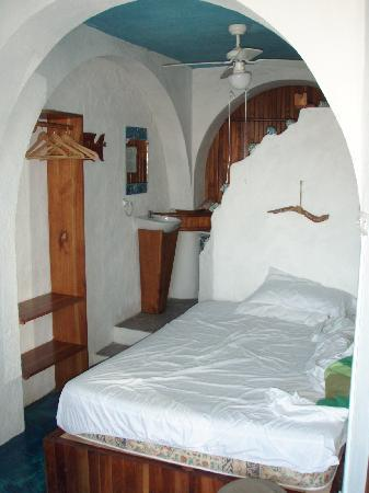 Casa Blanca: view of room standing at front door - see bathroom behind bedhead wall