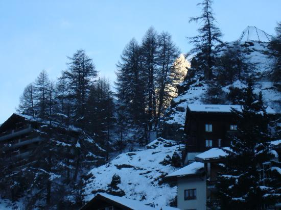 Hotel Alphubel Zermatt: From my balcony, a familia face begins to light in the morning sun.